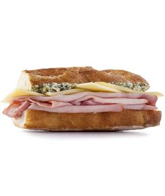 French Ham and Cheese Sandwich | A mixture of chopped cornichons, butter, Dijon mustard, and fresh tarragon gives this ham and cheese sandwich a French twist.