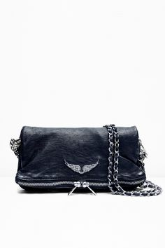 Zadig & Voltaire zipped clutch, two removable metal chains interlaced with leather, can be worn cross body or on the shoulder, large rhinestone winged rivet, 3x18x27cm/1.1x7x10.6
