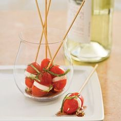 Mini Caprese bites, would be great served with a balsamic syrup to drizzle by nic heart
