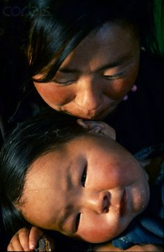Tsaatan mother and baby - Mongolia  Asian Mother.  Beauty.  Woman.  Strength.  Somebody's Mama.