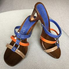Italian Shoemakers Bailey Sandal Bailey Sandal by Italian Shoemakers. Unique wooden heel with blue, orange, and tan straps. Worn maybe twice, has minor nicks on the bottom toe edge as pictured. Surprisingly very comfortable heel! Italian Shoemakers Shoes Sandals