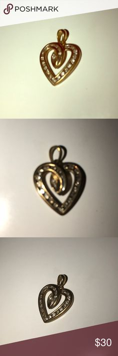 14k gold heart charm 14 karat gold heart charm. Cubic zirconia, could use a cleaning but very cute especially for a kid. Real gold. Jewelry Necklaces
