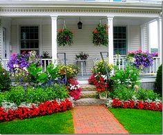 Front yard landscaped with tons of color.