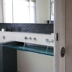 Contemporary tilted glass sink - perfect for public restrooms or guest bathroom.