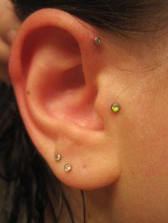 Tragus piercing.  Forward helix piercing.