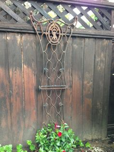 New Garden Trellis- bolted 2 vintage Singer sewing machine legs together.......