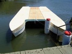 Houseboat Pontoon Hull & Hand made Bollar Houseboats and affordable small sailing yachts are the way of the future, as land and house prices become out of reach for the working mans pocket. This hull was built for a client as a clip on work shad juice boat, that the owner finished himself. My future thought is to design a trailer-able solar powered houseboat with built in composting toilet. #BoatPlansPontoon