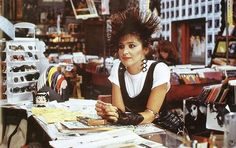 1986: Iona (Annie Potts) at TRAX, the record store in Pretty in Pink.