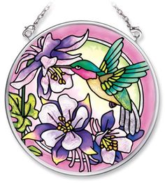 Amia Hand Painted Glass Suncatcher with Hummingbird and Columbine Floral Design, 3-1/2-Inch Circle by Amia. $15.15. Handpainted glass. Includes chain. Comes boxed, makes for a great gift. Amia glass is a top selling line of handpainted glass decor. Known for tying in rich colors and excellent designs, Amia has a full line of handpainted glass pieces to satisfy your decor needs. Items in the line range from suncatchers, window decor panels, vases, votives and much more.