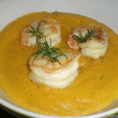 Crema di carote con gamberoni