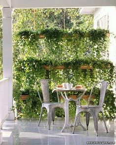 porch shade from gutters turned into hanging planters