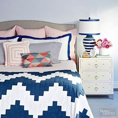 Blue isn't just reserved for boys under 10 -- it's one of the few colors that transcends both age and gender (just about everyone likes blue!). But it does require some savvy strategies to get it right. First, opt for a wall color with a bit of gray to stave off any comparisons to a nursery. Second, choose blues, accent hues, and patterns with high contrast (here, it's navy with white and the palest peachy pink) for a super sophisticated palette.