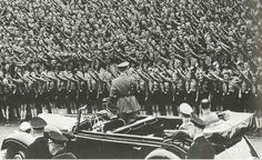 Thousands of young people giving the Nazi salute Hitler in a Hitlerjugend rally drive
