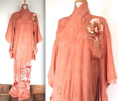 Vintage 1920s / 1930s coral pink hand painted kimono robe! Beautiful intricate design! Perfect for lounging in- Old Hollywood style!  MEASUREMENTS:  Fits a Small to Large  Chest: 48 Length: 62 Shoulder width: 28 Slv length: 13  CONDITION:  Good vintage condition - small hole near right collar. Lining has been cut out on top half. Some visible stitching on left sleeve.