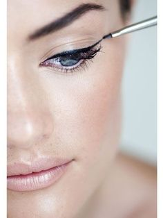 Keep your eyes open when applying liquid liner—otherwise your line will look uneven. Apply by drawing three dashes, one on the corner, one in the middle, and one on the inside corner of your eye. Then go back and connect the dashes for a smooth line.
