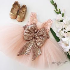 Princess Aisha Dress in Rose Gold styled with our Gjergjani shoes To order Gold Flower Girl Dresses, Toddler Flower Girl Dresses, Baby Girl Dresses, Toddler Dress, Baby Dress, Frocks For Girls, Birthday Dresses, 1st Birthday Girl Dress, Marie