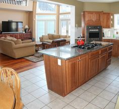 Beautiful Beautiful Center Island With Granite Countertop And A Gas Cooktop.
