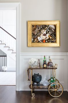 A festive photograph above a charming bar-cart in the Hamptons Hamptons Decor, The Hamptons, Online Gallery, Cool Things To Make, New Homes, Sweet Home, Gallery Wall, Interior Design, Prints