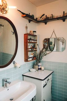 Wall shelving in bathroom. Btw mirror and shower
