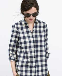Get your gingham on with this easy check shirt from Zara, pair with jeans and a parka for a laid-back weekend look.