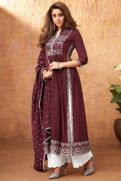 Specifically designed for a stylish lady like you is this maroon rayon trouser suit which will add oodles of charm to your special ethnic look. This This collar neck and 3/4th sleeve suit accentuated with thread work. Completed with cotton palazzo pant in white color with maroon georgette dupatta. Palazzo pant has chikankari work. #trousersuit #salwarkameez #malaysia #Indianwear #Indiandresses #andaazfashion