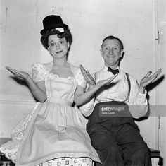 1942: Japanese-born actor Olivia de Havilland and British-born comedic actor Stan Laurel shrugging while sitting backstage at the Hollywood Victory Caravan. The Caravan was a tour of Hollywood stars benefiting the American war effort in World War II.