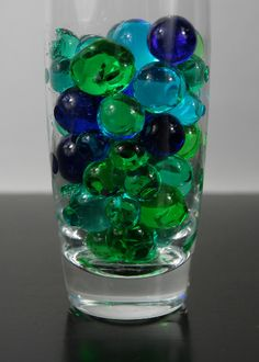 these are the water beads to go in the vases.  mix and match colors etc.  Blue Jumbo Water Pearls $14.89 (5.2 oz/ 150ml)
