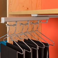 Particularly suited to deep, narrow spaces, the Ambos Pull Out Hanger Rack extends out (as shown here) to assist with finding the item you want, and is top mounted so it can be installed under shelves.