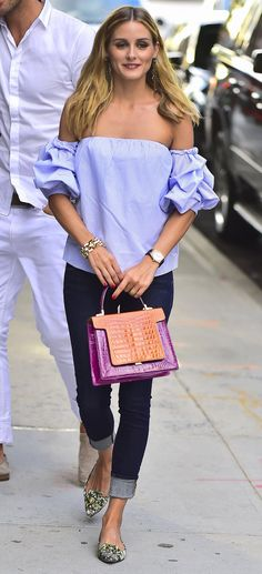Olivia Palermo looks fantastic in an oversized off-the-shoulder top made of light poplin fabric.