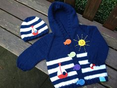 Knitting Patterns Wear Jackets – picture book jacket and cap 'Holidays by the sea'! – a unique design by Sonnenkinder at DaWa … Crochet Baby Jacket, Crochet Baby Sweaters, Baby Sweater Knitting Pattern, Knitted Baby Cardigan, Baby Knitting Patterns, Crochet For Boys, Knitting For Kids, Hand Knitting, Baby Outfits