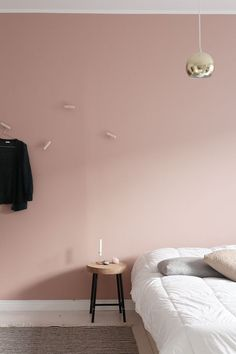 Minimal bedroom with blush pink wall.