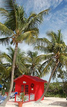 Little red beach cottage in exotic Caribbean destination
