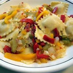 Cheese Ravioli with Three Pepper Topping Recipe- add cream to sauce  towards the end, include garlic, basil, and oregano when sauteing onions- finish sauce with parmesean cheese