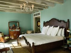 This bedroom at the Soho Beach House has the perfect serene paint color. And a bar!