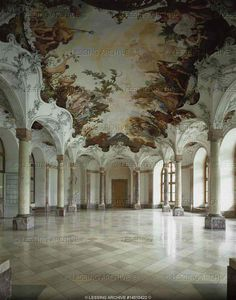 """Neumann,Balthasar.Wuerzburg residence,Sala Terrena, 1750. The vault is supported by walls and rows of columns. Stucco decorations by Antonio Bossi, 1749. Ceiling fresco """"Banquet of the Gods"""" by Johann Zick, 1750 For Wuerzburg see 14-02-02/46-58, 14-01-04/21-43"""