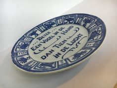 """Vintage Commemorative Blue & WHite Dutch Plate/ Wall Decor 9"""" Inches Plate reads, """"Beter Een Vogel in De Hand Dan Tien in De Lucht"""" by TheDustyWingVintage on Etsy"""