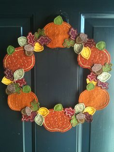 Upcycled Felted Wool and Wool Felt Autumn Pumpkin and Leaf Wreath. - cute, maybe as a centerpiece?