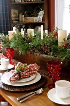 Woodland Christmas tablescape~ love the wood box filled with greenery and candles.