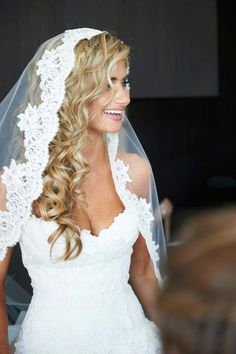 lace white wedding veil with long curly blonde hair down