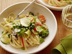 Pasta Primavera is the perfect spring dish. Ree Drummond mixes carrots, mushrooms, broccoli, zucchini and summer squash into fettuccine for this beautiful vegetable-filled pasta.