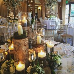 Inspiration for a forest or rustic woodland wedding table ~ Red floral architecture
