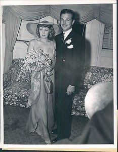 Actor Dick Powell and actress Joan Blondell were married 1936-1944. He was married to actress June Allyson from 1945 until his death in 1963. Joan was  married to producer Mike Todd 1947-1950.
