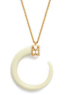 Sleek and simple, this beautiful necklace offers an elegant take on the tribal motif, with its delicate chains and stylized crescent pendant.