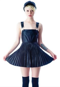 Darling navy blue overall dress and knee high socks.