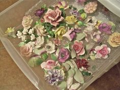 collection of ceramic flowers...how to chip them off old stuff