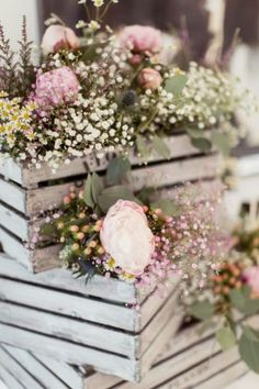 Country garden wedding flowers peonies, gypsophila and thistle wooden crates wedding decor