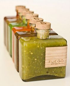 "Love the simple design of this packaging and the combination of glass and wood textures. Plus, this allows the product to shine through, and seeing all those pepper seeds really helps to convey that this hot sauce is indeed ""fuego""."