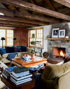 "The fireplace in the living room matches the outdoor stone ""Clifford"" wall outside, creating a uniform look throughout."
