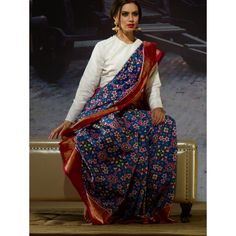 A classic Patola - unique combination and the beauty lies in the weave Exclusive Blue Pure Handloom Silk Saree - saree.com