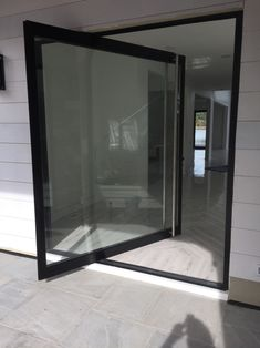 This ActivWall Pivot door adds a unique and modern feel to any residential and commercial space. #doors #pivotdoor #wineroom #patio #entryway #diningroom #divider #customhomes #custombuilder #remodel #renovation